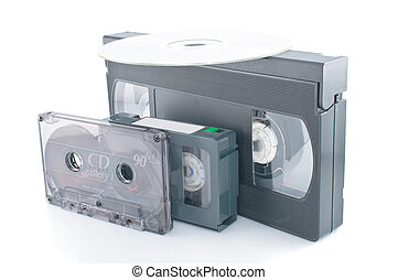 Compact videocassette , VHS and DVD isolated on white background