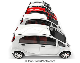 Compact white electric cars in a row - red stands out - top view