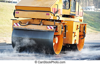 compactor roller at asphalting work - Heavy Vibration roller...