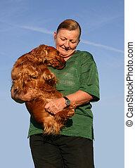 companion dog - old woman and her purebreed english cocker