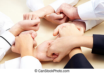 Companionship - Image of business people hands holding other...