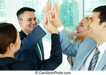 Portrait of business group keeping hands close to each other meaning support