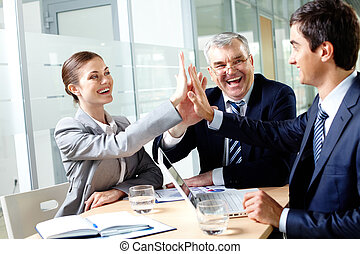 Companionship - Portrait of business group keeping hands...