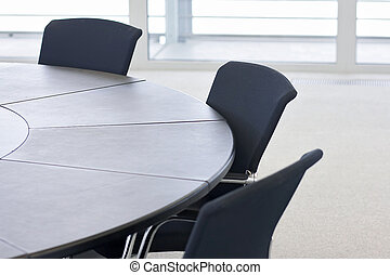 company at table - Chairs in a conference room