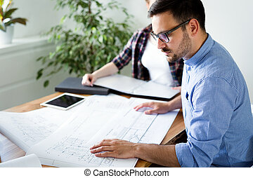 Company coworkers working in office