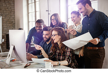 Company employees working in office