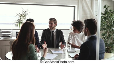 Company executive motivating diverse team giving high five ...