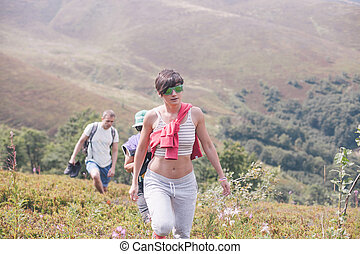 company walking in the mountains