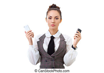 Compare the two mobile phones - Businesswoman thinking about...