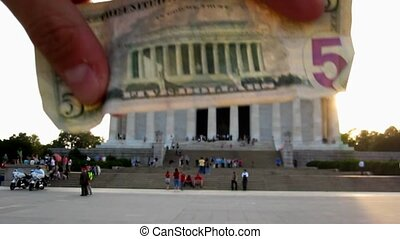 Comparing 5 dollar bill image with real Abraham Lincoln Memorial , Washington D.C, USA.