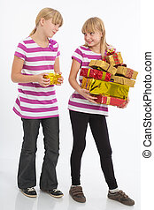 Comparing gifts - Two Girls compare their gifts