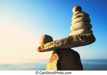 Comparison of stones - Zen balance of stones at seashore