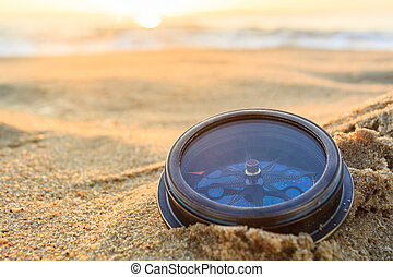 Compass. - Ancient compass on the sand at the Beach Sunrise...