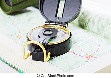 Compass and binoculars on map closeup