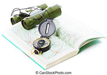 Compass and binoculars on map