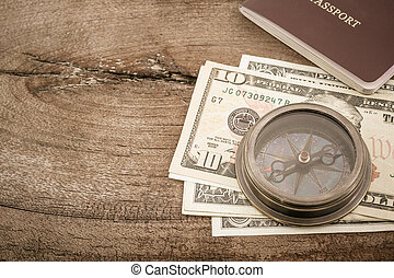 Compass and dollar banknote.