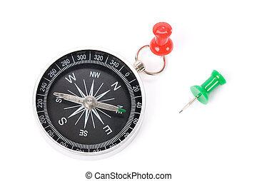 Compass and pushpin close up shot, business concept