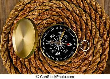 compass and rope on a wooden table