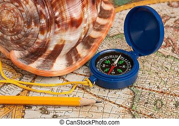 compass and seashell