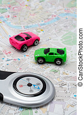 Compass and two cars, on the map