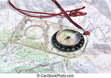 compass card on long hikes - compass placed on a road map of...