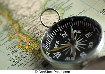 compass close up shoot on a retro map