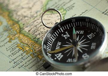 compass close up shoot on a retro map