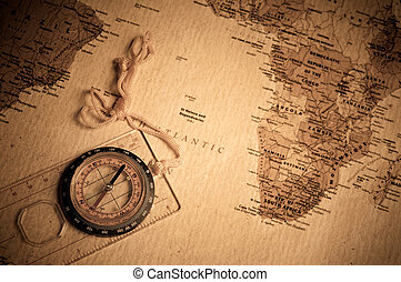 Compass - compass on old world map.