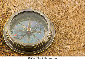 Compass on wood background.