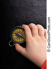 Compass in hand  as a concept of traveling and finding your life