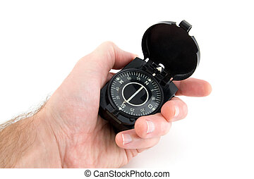 Compass in the hand on white