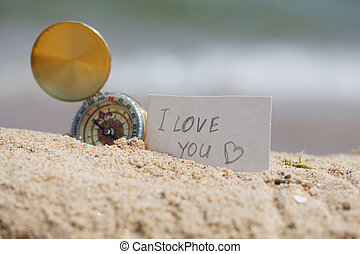 Compass in the sand with Message - I love you