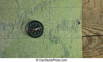compass maps and notebook study the terrain overhead shot in...