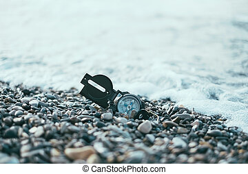 Compass near the sea waves