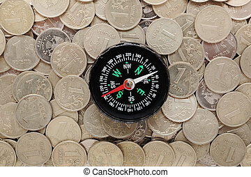 compass on a heap of coins