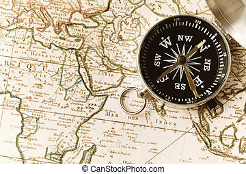 compass on a map - very old texture of toned print,...
