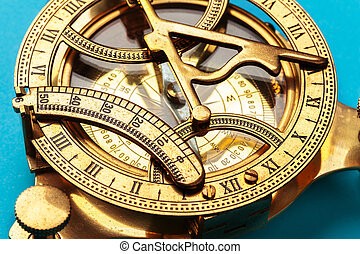 Compass on blue background, top view. creative photo.