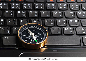 compass on computer keyboard, business decision
