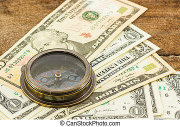 Compass on dollar banknote .