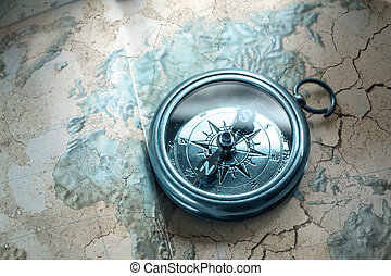 Compass on map background