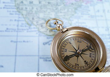 Compass on map background, use for travel concept