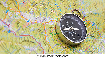 Compass on map, close up