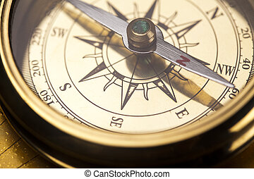Compass on old map - Old navigation instrument, map and...