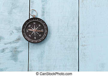 Compass on the blue wooden floor.
