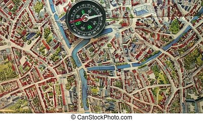 compass on the map orientation in the metropolis - compass...