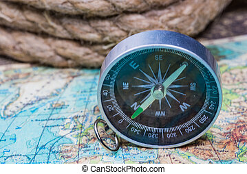 compass on the world map - compass lies on an ancient world...