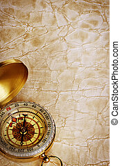 Compass on vintage old paper background