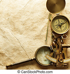 Compass on vintage paper - Close up view of compass on...