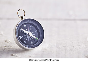 Compass On White Wooden Table