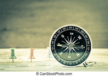 Compass on world map.
